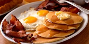 All Day Bacon and Eggs Breakfast with Pancakes and Syrup